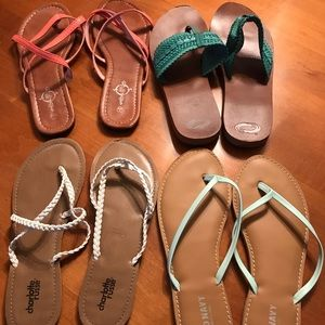 Four pairs of slightly worn flat sandals